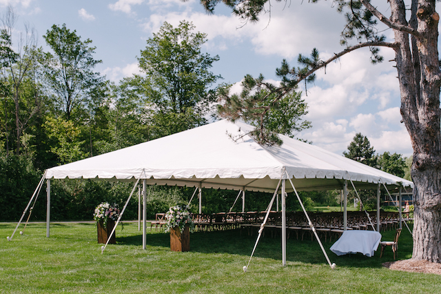 Happenings Party Rentals 30x60 NaviTrac Frame Tent and Crossback Chairs for Wedding Ceremony