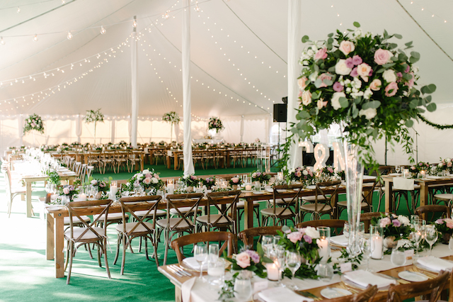 Happenings Party Rentals Harvest Tables Cafe Lights Crossback Chairs Centre Pole and Side Pole Drapes in a the 50x100 Pole Tent