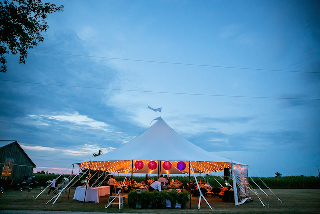 Happenings Party Rentals Stillwater Pole Tent in Stratford at Dusk