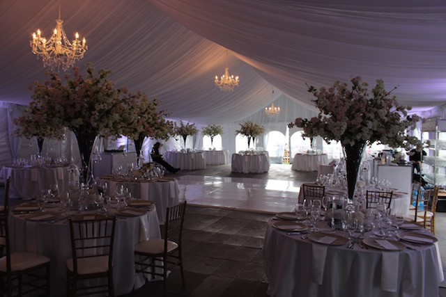 Happenings Party Rentals 40X75 Clearspan with Liner Chandeliers Flooring Dance Floor Round Tables and Chiavari Chairs