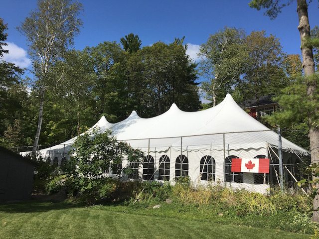 Happenings Party Rentals 50X100 Pole Tent on a Tennis Court in Thunder Beach