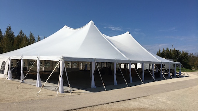 Happenings Party Rentals 60X90 Pole Tent with Side Pole Drapes and Flooring at Blue Mountain